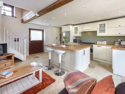 Photo for A truly romantic retreat. This stunning and stylish barn conversion lying on a smallholding on the o