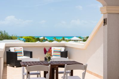 Huge terrace with ocean views. Comfy chairs, al fresco dining and sun lounger