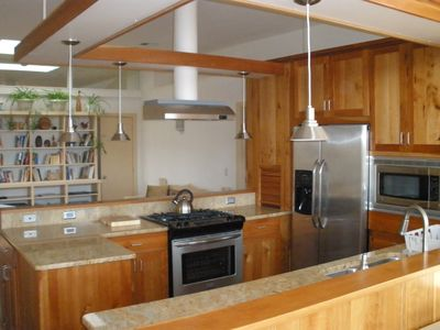 Open plan kitchen with living area beyond