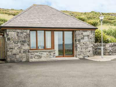 Photo for CONNOLES COTTAGE, with a garden in Fanore, County Clare, Ref 970404