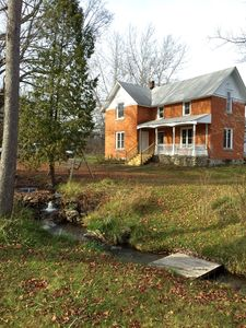 Photo for Beautifully Restored Brick Home, Sleeps 8, Two Miles From Lake Charlevoix.