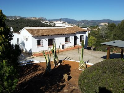 Front of villa with shaded private parking