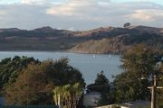 Peaceful Harbour View From This Kiwiana Beach Home