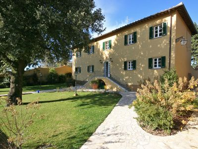 Photo for Apartment with WIFI, pool, TV, washing machine, panoramic view, parking, close to San Gimignano