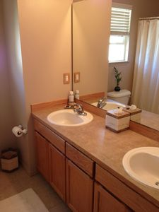 Bathroom has 2 sinks, shower, & tub. It is shared with other guests.