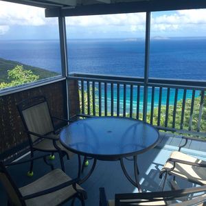 Gaze at the ocean as you dine in the screen porch!