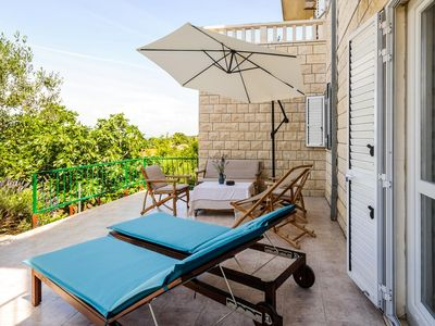Photo for Three bedroom apartment with terrace and sea view Sutivan, Brač (A-2851-c)