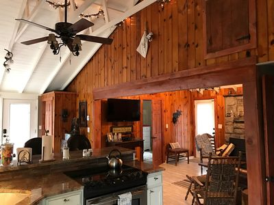 Exposed ceiling beautiful garland lights, kitchen opens to dining n living are