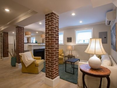 Photo for Open, exposed brick, loft like apartment at public transit,