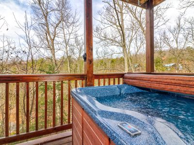 Photo for Cabin w/ a private hot tub, game room, & gas fireplace - close to attractions!