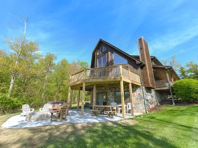 Dog friendly home with lake access, private basketball court, and hot tub!