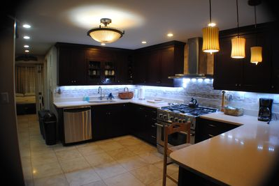 Kitchen has 6 burner stove, microwave, dishwasher and Thermador refrigerator.