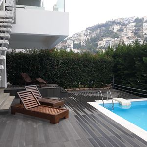 Photo for Sea view 2-level apartment with pool&yard