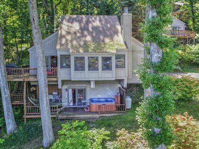 Photo for Dog-friendly lakefront home w/ hot tub, dock, shared tennis - near the slopes!