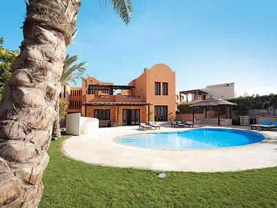 Photo for Tranquil villa minutes from the marina w/ terrace, pool and garden