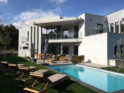 Photo for Contemporary villa in a quiet area, heated swimming pool, quality facilities