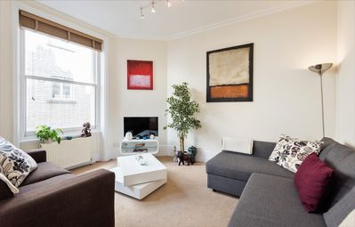 Very large, comfortable, modern lounge - TV, large windows with light, sofa-bed