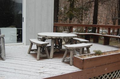 The deck has several sitting areas