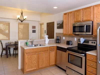Photo for Two bedroom, two bathroom poolside condo with gas fireplace, sofa sleeper and fully equipped kitchen