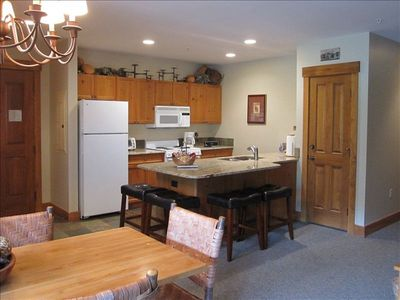Upgraded granite countertops in kitchen with counter seating for four