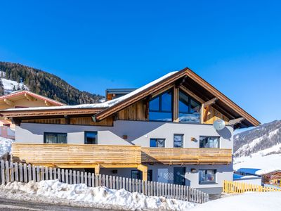 Photo for Spacious detached house directly by the piste - ski in/ski out