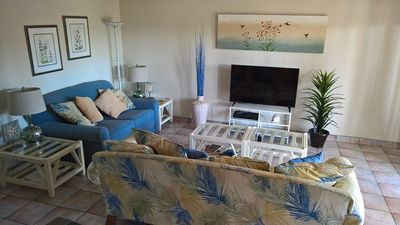 Photo for Second floor condo half block from beach. Sleeps 6, 2 bedrooms, 2 baths. Pet-friendly. Shared Pool.