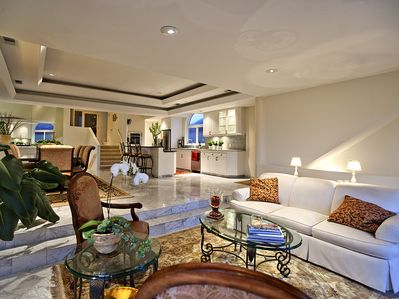 The living room, dining room and kitchen are on the mid-level.