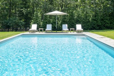 Sunny all day; heated Pool w/lounge chairs, umbrella& side tables.