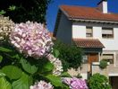 House with garden only 5 m walking from the house and 20 m from Santander.