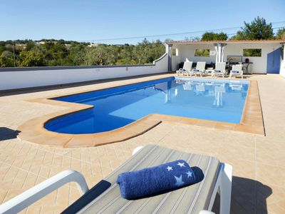 Photo for This 4-bedroom villa for up to 8 guests is located in Estoi and has a private swimming pool, air-con