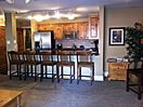 Six counter chairs at granite eating counter