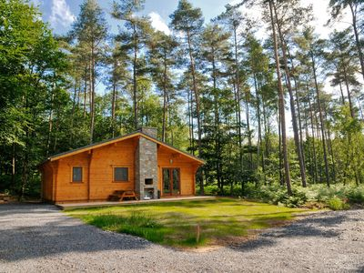 Photo for Recently built, modern chalet with wood stove, situated in a wooded park
