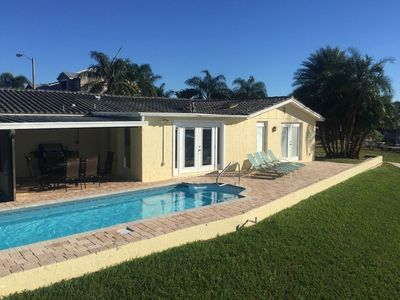Photo for Wonderful canal front home with its own beach bar and heated pool! Come Relax