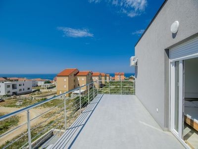 Photo for Two bedroom apartment with terrace and sea view Novalja, Pag (A-17954-h)