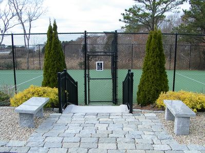 2 hard packed tennis courts with a water view!