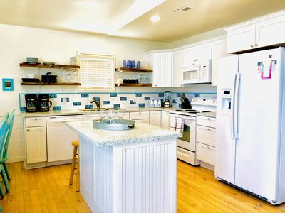 Bright, renovated kitchen with granite countertops and open shelving!