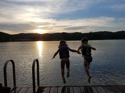 Jumping off the dock into the sunset.