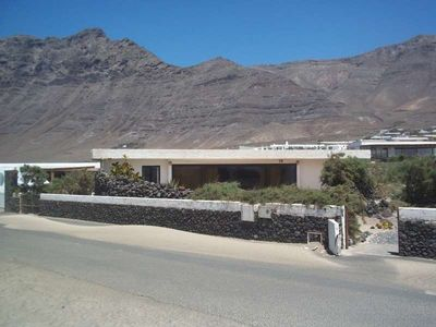 Photo for Bungalow TONZEFY in Famara for 4 persons with terrace, garden, views to the ocean, views of the volcanoes, WIFI on the go and less than 200m to the sea