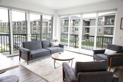 This unit has bright and airy vibes with the floor to ceiling windows!