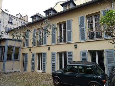 Photo for Warm and very quiet town house just steps from the Chateau de Versailles
