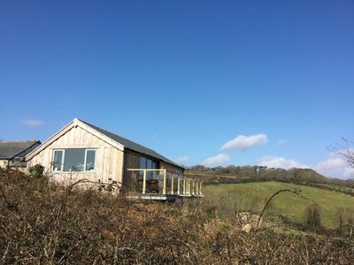 Photo for Stunning sea views to Mounts Bay yet set in a tranquil wooded country valley.