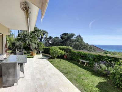 Photo for Appt-villa, superb sea view, private garden 520 m² pine trees, palm trees, olive trees ...