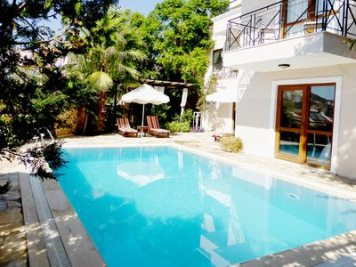 Photo for Luxury private villa, sea views, pool, short walk to restaurants and shops.
