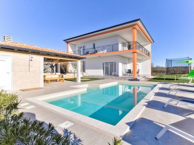 Photo for Vacation home EVA (UMA390) in Umag - 8 persons, 4 bedrooms