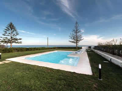 Photo for Stunning seafront villa with pool and panoramic view.