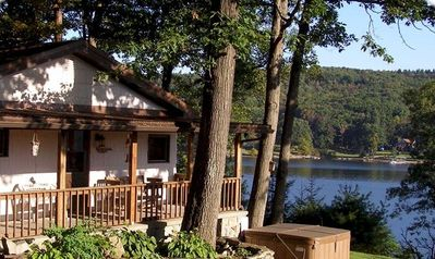 Lake Front, Private Dock, Hot Tub, and Wood Burning Fireplace.