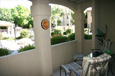 Condo patio overlooking 2nd pool area with hot tub and communal BBQ's