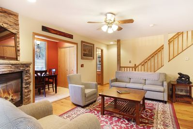 Elk Haven EV Reg#6079 - Main floor level living room with comfortable seating and gorgeous stone fireplace.