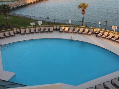 Main pool.  One of 3 pools available.  Lots of furniture.  View is from balcony.