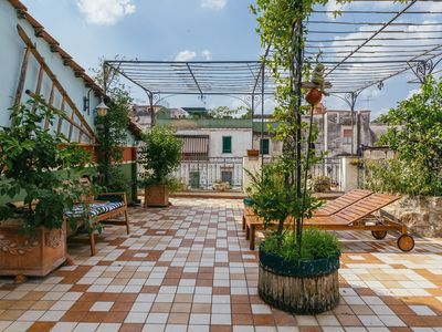 Photo for The Lemon Tree Terrace - surrounded by the biggest ancient city center worldwide